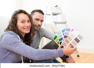 View of a Young couple choosing colors of their new flat