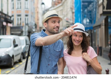 View of a Young couple visiting city during holidays
