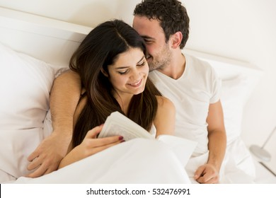 View at young loving couple in the bed