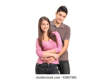A view of a young loving couple in an embrace isolated on white background