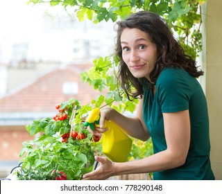 View of a Young woman hoping not killing her plant with chemistral product - Ecology and nature theme