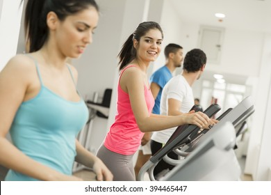 View of the young woman training in the gym