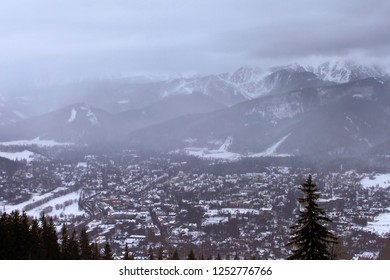 View of Zakopane and Tatra Mountains from Gubalowka in the winter in snowing weather. Zakopane is the Winter Capital of Poland