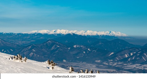 view to Zapadne and Vysoke Tatry mountains with Velka Fatra mountains on the frontside from Martinske hole in Mala Fatra mountains in Slovakia during winter day with clear sky