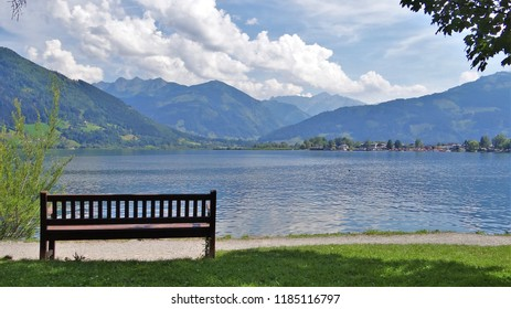 View of Zell am see Kaprun lake with a bench at the foreground