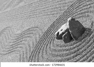 View of the zen garden with raked gravel sand and rocks, traditional Japanese temple settings, black & white photo