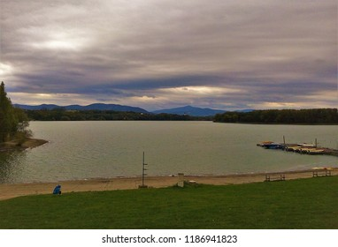 View of Zermanice Dam, a beautiful water reservoir built on the Lucina River near Beskydy Mountains in Czech Republic. Zermanice harbor with boats on cloudy autumn day.