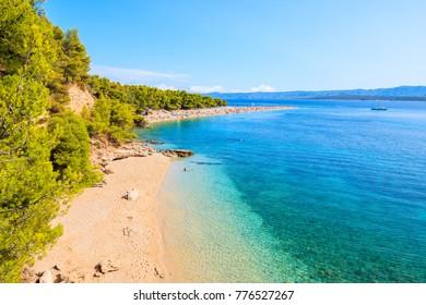View of Zlatni Rat beach (Golden Horn) with beautiful sea water, most famous beach of Adriatic Sea, Brac island, Croatia