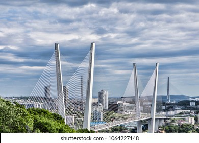 View of Zolotoy Bridge among clouds in the city of Vladivostok