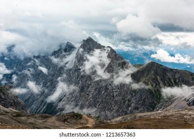 View from Zugspitze mountain toward Austria. Summer cloudy shot.Altitude 2650 meters