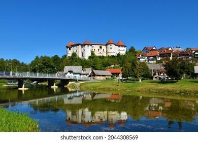View of Zuzemberk castle in Suha Krajina, Dolenjska, Slovenia from across river Krka and a reflection of the castle in the water - Shutterstock ID 2044308569
