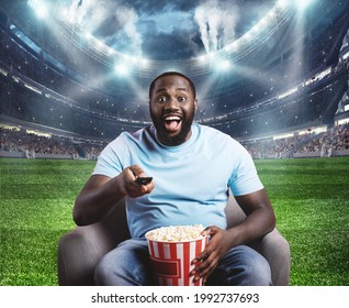 Viewer is located in the middle of the stadium sitting on his armchair