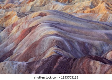 The viewer is presented with an unimaginable array of colors and shades. These are formed from chemicals leeching through rocks caused by flash flooding and intense heat from the sun.