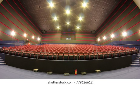 viewers fill the cinema hall and watch motion picture at movie theatre timelapse. Red chairs and big screen