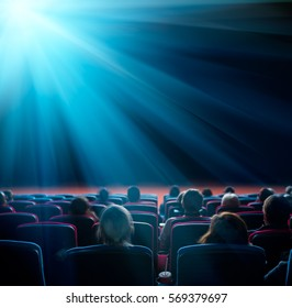 viewers watch shining star in cinema, long exposure, blue glow
