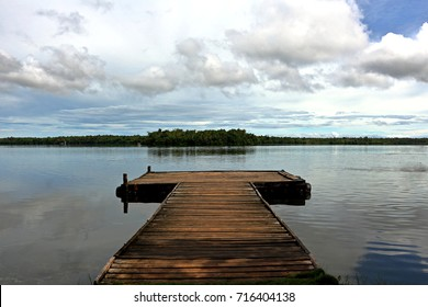 A viewing board over the lake in Camotes island. This fresh water body is habitat to many species of aquatic plants and animals including the forest of mangroves visible at the horizon.