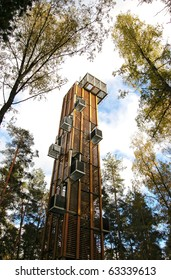 Viewing tower in park among trees