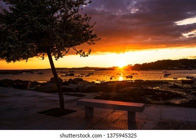 Viewpoint with bench to observe the beautiful sunsets from Abilleira beach in Arousa Island
