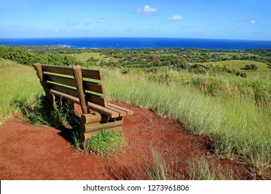 Viewpoint for Hanga Roa and Pacific Ocean with a Wooden Bench on Red Scoria at Puna Pau Volcano, Moai Statues' Topknots Quarry on Easter Island, Chile