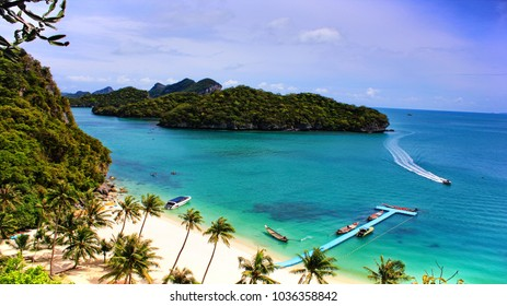 Viewpoint look at the beach and sea islands and going motorboat in Angthong National Marine Park in Thailand
