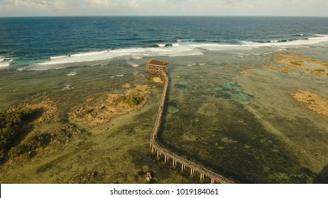 Viewpoint in the ocean at Cloud Nine surf point, Siargao island , Philippines. Aerial view raised wooden walkway for surfers to cross the reef of siargao island to cloud 9 surf break mindanao. Siargao