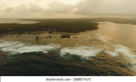 Viewpoint in the ocean at Cloud Nine surf point at sunset, Siargao island , Philippines. Aerial view raised wooden walkway for surfers to cross the reef of siargao island to cloud 9 surf break