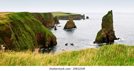 viewpoint on duncansby head scotland towards several sea stacks