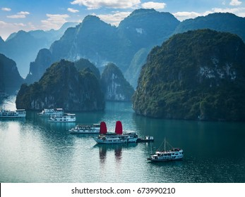 Viewpoint over Halong Bay with cruise ships in the ocean, Southeast Asia. UNESCO World Heritage Site. Beautiful scenery with sea and mountains, most popular landmark, tourist destination of Vietnam.