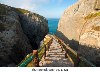 The viewpoint at Suicide Cliff onto the ocean, a tourist attraction inspired by legend, seen from the top of the entrance stairs on Dongyin island in the Matsu archipelago of Taiwan
