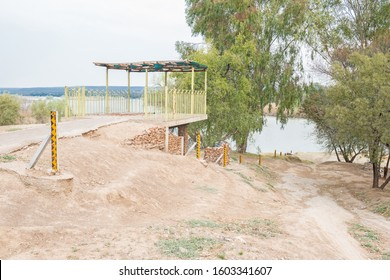Viewpoint with water level markers at the confluence of the Gariep (Orange) and Vaal Rivers near Douglas in the Northern Cape Province of South Africa