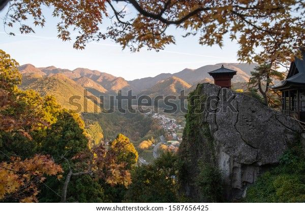 Viewpoint Yamadera village mountain with autumn leaf trees in evening from Yamadera shrine, Yamagata, Japan. Yamadera Risshaku ji temple.