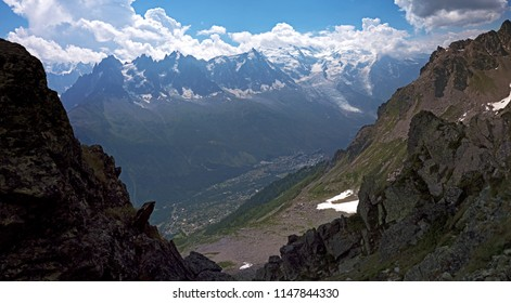 Views Across the Chamonix Valley toward the Mont Blanc Massive and Mont Blanc through the clouds. Located in the Alpine town of Chamonix in the French alps.