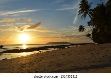 views of the brown sand beach and sunset on the beautiful island. Island of Papua Indonesia