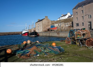 Views of Burghead harbour with the fishing fleet in port Scotland UK