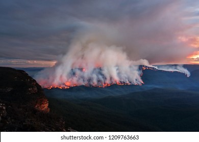 Views of the bush fire at Mount Solitary in Blue Mountains after sunset at dusk light