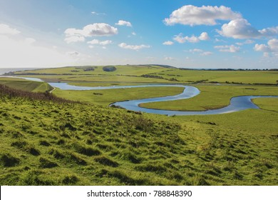 Views of the Cuckmere Valley and the Cuckmere River meandering to the sea near Eastbourne in East Sussex.