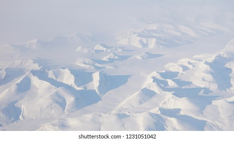 Views down on Greenland from the Airplane Window.