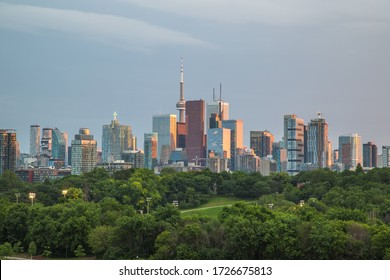 Views of the downtown Toronto skyline around sunset time. Showing skyscrapers, office buildings and condos in the distance.