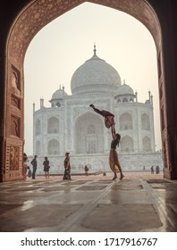 Views of a girl waving a pashmina in the air in front of the Taj Mahal during the sunrise. Picture taken on the 11/12/2019 in Agra.