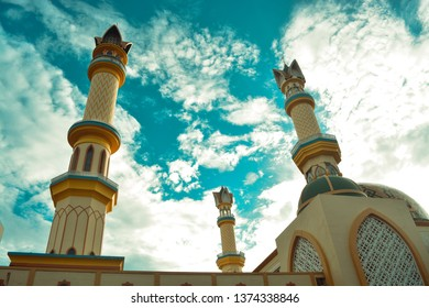 Views of the great mosque of Mataram, Lombok Islamic Center with a tall tower. yellow and green with a beautiful blue sky