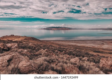Views of Great Salt Lake at Antelope Island State Park, Utah, USA. Desert landscape, water reflections, dramatic clouds.