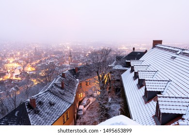 Views of the illuminated old town of Wernigerode. Ice and snow on the roofs.