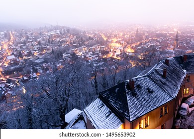 Views of the illuminated old town of Wernigerode in the case of ice and snow at dawn