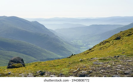 Views of Invervar in Glen Lyon from the mountain summit of Carn Gorm with Meall na Aighean to the left in the Scottish Highlands, UK landscapes.