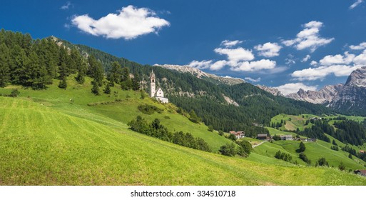 Views of La-Val (Wengen) hiking village and Tolpei agri-tourism village from the hiking trail around La Val with Sasso di Santa Croce mountain in the background, Dolomites, Alta Badia,  Italy