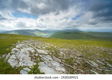 Views of Loch Daimh and mountain summits of Stuc an Lochain, Meallan Odhar and Sron Choire Chnapanaich from the summit of Meall Buidhe in the Scottish Highlands, UK landscapes.