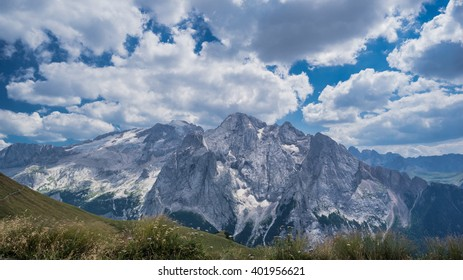 Views of Marmolada mountain massif, Gran Vernel and Collac summits and Lago Fedaia as seen from trekking trail 601 Fedaia lake to Viel del Pan refuge and to Passo Pordoi, Dolomites, Italy
