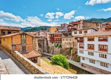 Views of the medieval village of Potes with hanging houses and Deva river, Cantabria, Spain.
