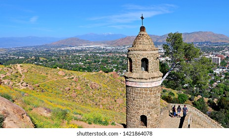 Views from Mount Rubidoux of Riverside, Calif. with the Peace Bridge and Tower monument in the foreground, built in 1925.  Urban development has filled the valley below.