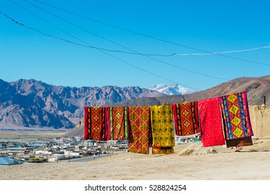 The views of Murghab (Murghob) village, in Pamir mountains,Gorno Badakhshan Autonomous Region, Tajikistan,Central Asia. Locates on Pamir Highway. Colorful blankets in the frame.